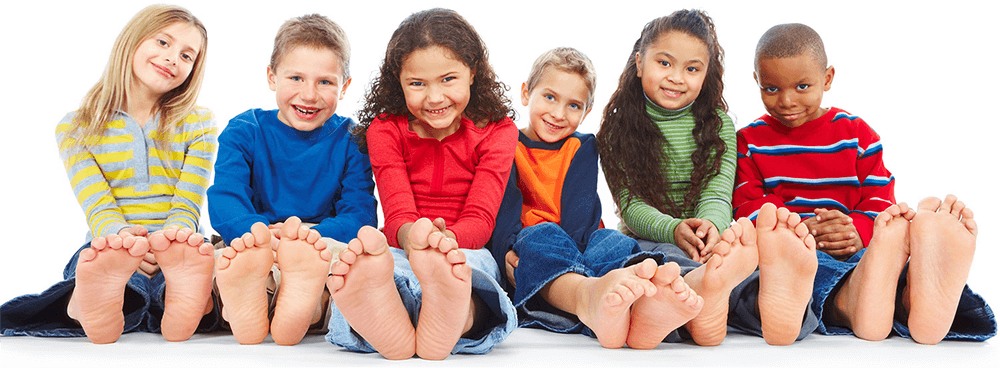 Children sitting with feet showing